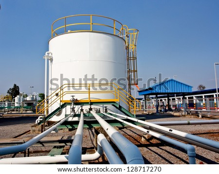 storage tank and pipe lines  in chemical plant - stock photo