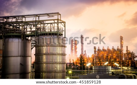 storage tank with petrochemical plant background - stock photo