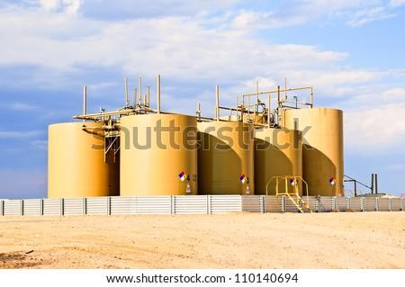 Storage tanks for crude oil in central Colorado, USA - stock photo