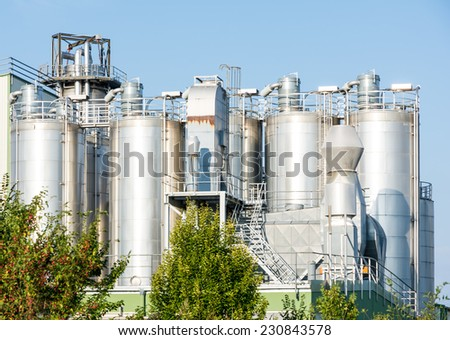 Storage tanks of a chemical plant - stock photo
