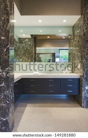 Storage units and mirror in bathroom of California home - stock photo