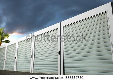 storage units boxes photographed at sunset - stock photo