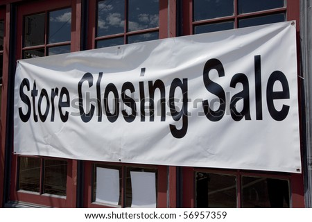 Store closing sign on small retail store. - stock photo