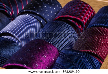store display and assortment of coiled neckties