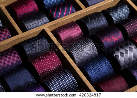 store shelf and rolled luxury neckties.