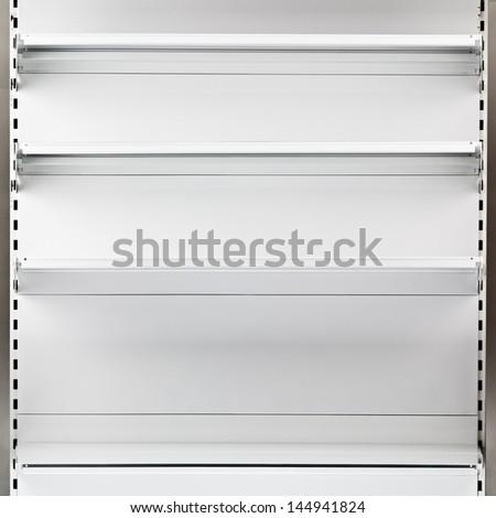 store shelf. supermarket equipment - stock photo