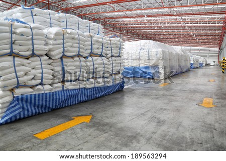 storehouse with stacked sacks of meal  - stock photo