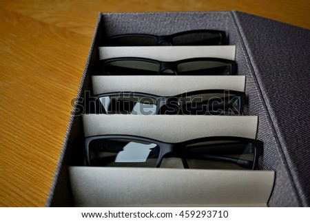 Storing box with separated compartments separating the glasses, sunglasses and 3D glasses - stock photo