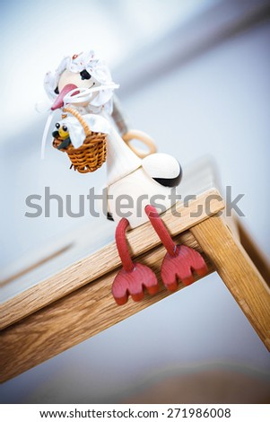 Stork carrying a cute baby. Child delivery by a white stork  - stock photo