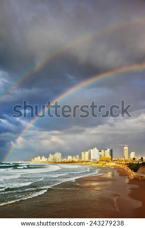 Storm and a rainbow in the Mediterranean. Promenade and a huge beach in Tel Aviv - stock photo