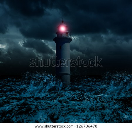 Storm and flooded lighthouse - stock photo