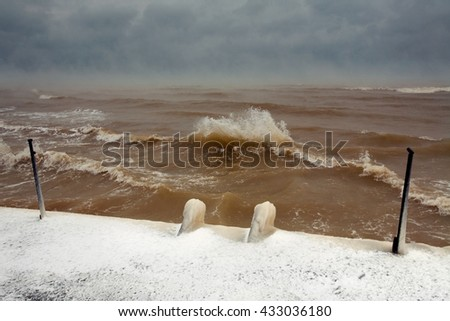 Storm and fog sea in winter with snow - stock photo