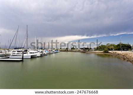 Storm approaching over the marina at Scarborough, Queensland, Australia - stock photo