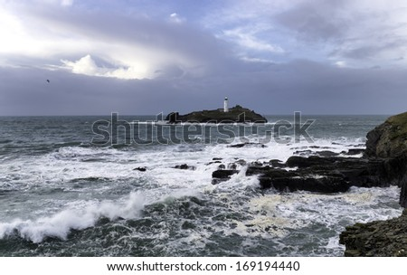 Storm at Godrevy Island and its lighthouse off the coast at St Ives in Cornwall - stock photo