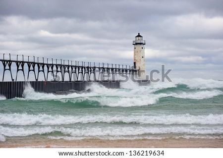Storm at lake Michigan Manistee Pier Lighthouse USA - stock photo