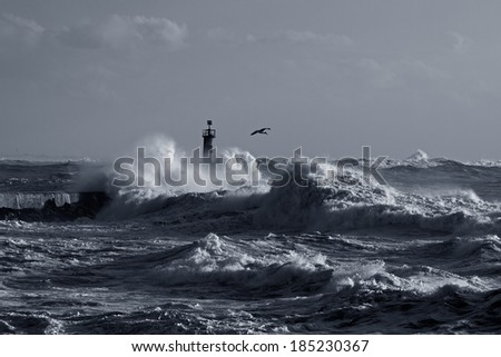 Storm at the mouth of Ave river, Vila do Conde, Portugal. Black and white toned blue.