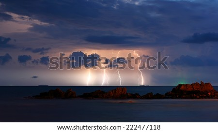 Storm beginning with lightning - stock photo
