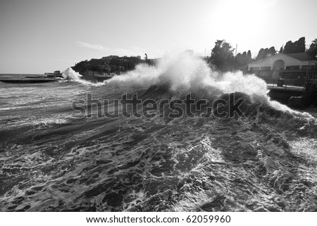 Storm. Big wave near the pier - stock photo