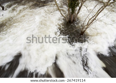 storm causes flooding of rivers - stock photo