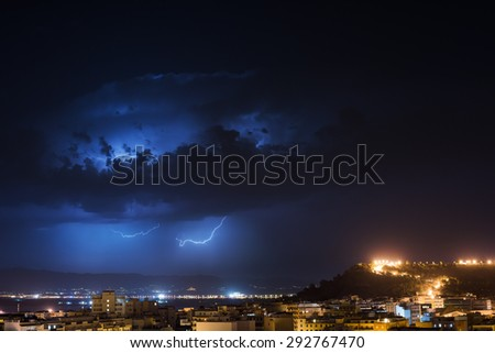 Storm cell over the city by night - stock photo