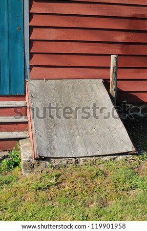 Storm cellar under a barn. - stock photo