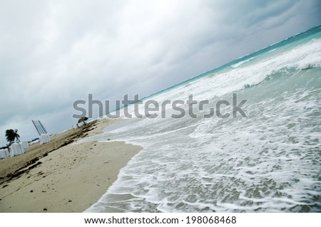 Storm clouds above a tropical beach - stock photo