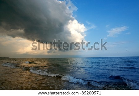 Storm clouds approaching from the roller tropical beach
