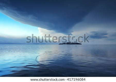 Storm clouds are reflected in the ice of Lake Baikal