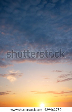 Storm clouds at sunset. Genuine vertical natural composition