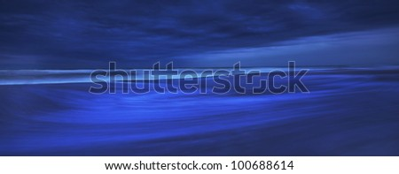 Storm clouds at twilight over sandy beach on the Atlantic shore and recessing tide - stock photo
