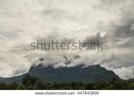 Storm clouds cover the mountain