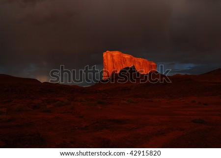 Storm clouds gather over Monument Valley - stock photo