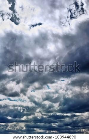 Storm clouds in dark sky - stock photo