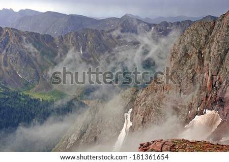 Storm Clouds in the Mountains - stock photo