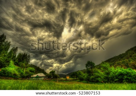 storm clouds in village