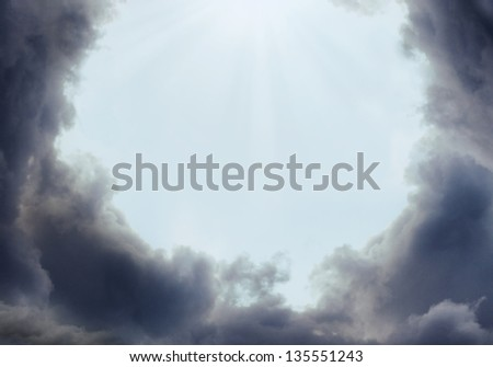 Storm clouds on clear sky