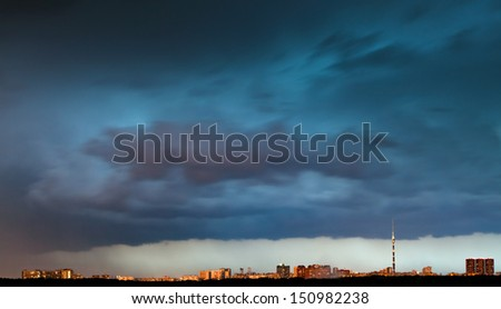 storm clouds over city in summer evening