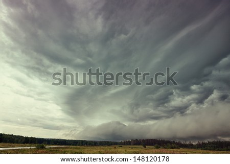 storm Clouds over field. Siberia.Russia - stock photo