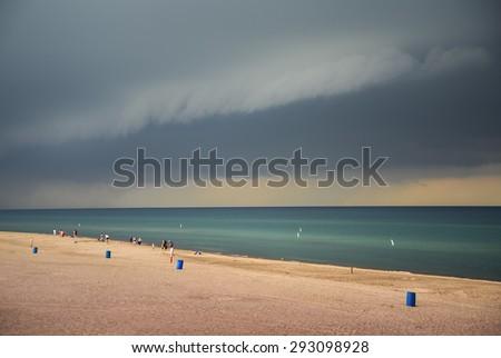 Storm clouds over lake Michigan beach - stock photo