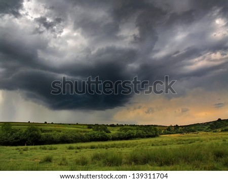 Storm clouds over pasture