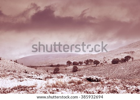 Storm clouds over snow covered Glenmore Forest Park, Cairngorms in the Scottish Highlands, UK. - stock photo