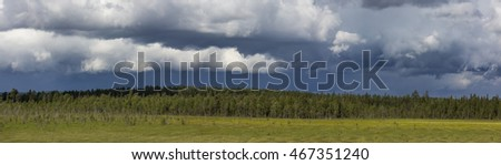 storm clouds over the forest of Lapland