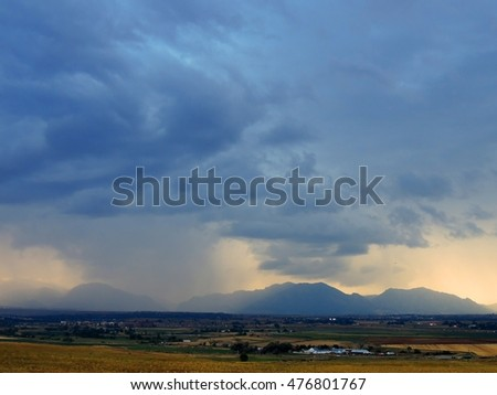 storm clouds over the front range of the rocky mountains as seen from broomfield, colorado