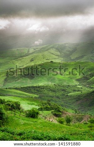 Storm clouds over the valley in Tuscany - stock photo