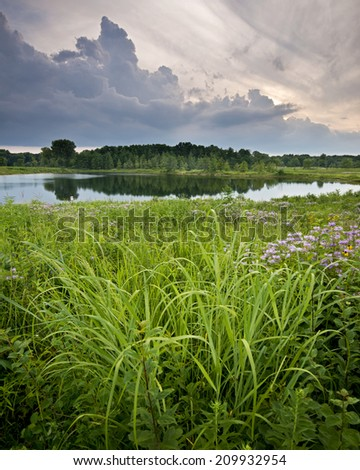 Storm clouds over White Pine Pond at Blackwell Forest Preserve, DuPage County, Illinois - stock photo
