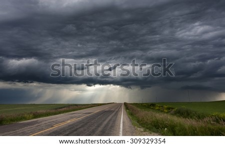 Storm Clouds Prairie Sky Canada Ominous danger - stock photo