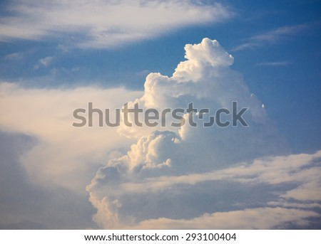 Storm clouds rolling past clear skies - stock photo