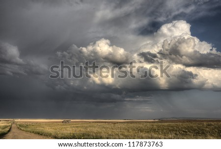 Storm Clouds Saskatchewan billowing clouds and gravel road