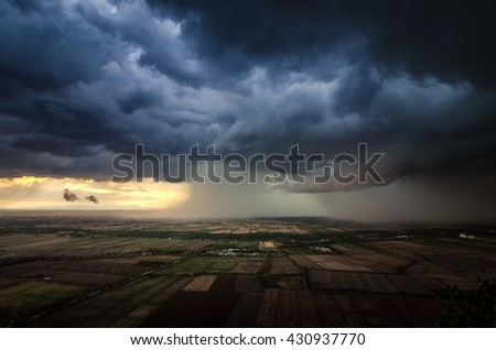 Storm clouds with the rain in Thailand - stock photo