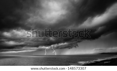 Storm Coming Over the Sea with lightning, with themes of nature, depression and darkness.